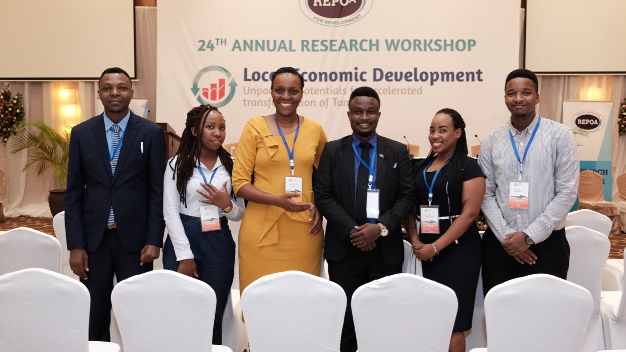 Young EST members volunteered at REPOA'S 24th Annual Research
